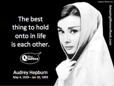 Audrey Hepburn hold onto each other